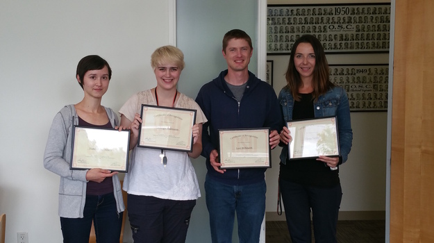 Intern's Receive Certificates on Their Last Day
